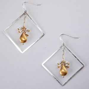 Boxer Earrings $51, Hurricane by Jane Jewelry